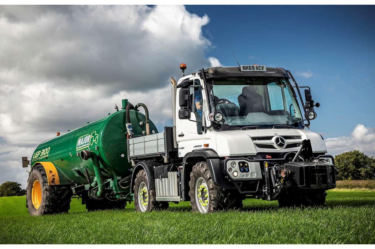 Mercedes Unimog Working on Farm with Silage Trailer