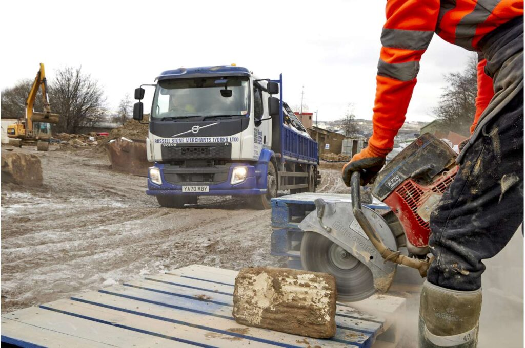 Volvo FL Crane Truck in mud